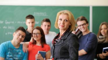 a professor standing in front of a group of students